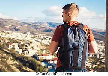 Man traveler with backpack enjoying the natural surroundings
