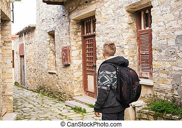 Man traveler with hat and backpack enjoying view