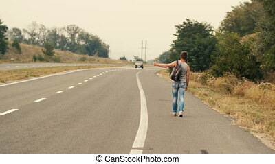 Man traveling by auto stop - Handsome young man hitchhiker...