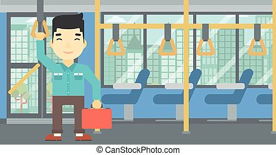 Man traveling by public transport. - An asian young man...