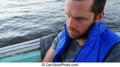 Man travelling in motorboat 4k - Thoughtful man travelling...