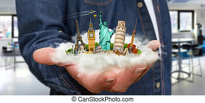 Man travelling the world - Young man holding a cloud full of...