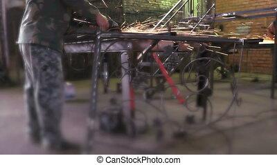 Man treating, polishing steel partitions