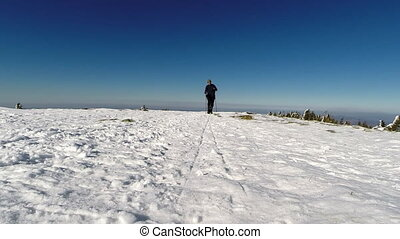 Man trekking in fresh powder snow in the mountains