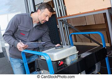 man tries to start generator