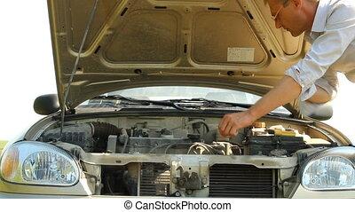 Man troubleshoot a broken car under