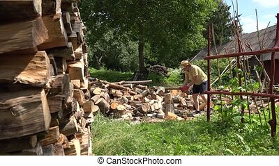 Man try to chop wood log but fail. Static shot.