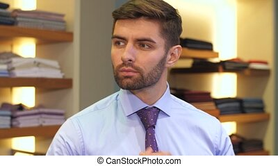 Man trying on a new tie