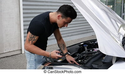 Man trying to fix his car