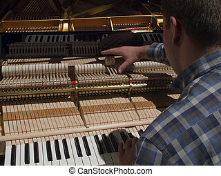 man tunes a piano - Tuning Piano with Audio. Close up shot...