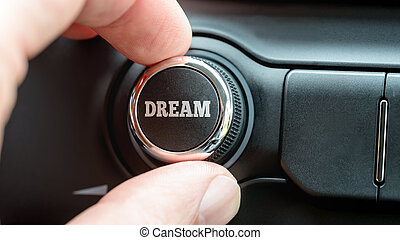Man turning on a dream button with the word - Dream