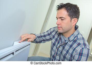 man turning on the fuse box