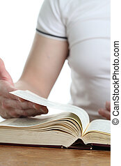 Man turning the page of the Bible