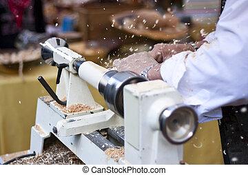 Man turning wood