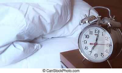 man turns off the alarm