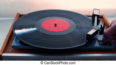 Man Turns on a Turntable With a Record - Turntable with a ...