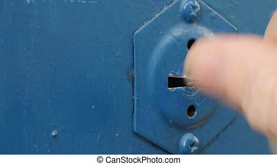 man turns the key in the keyhole close-up, with sound
