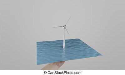 Man twists in hand a wind turbine located on water. Light gray background. Alternative ecologic power generation. 4K footage