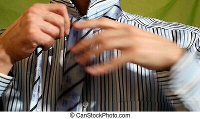 tie - Man tying his tie a tie