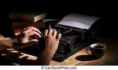 Man typing a typewriter at night creates a new novel