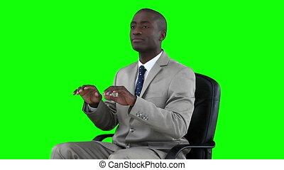 Man typing on a digital keyboard