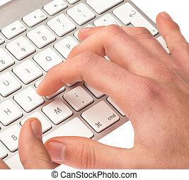 man typing on a keyboard