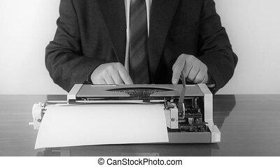 Man typing on a manual typewriter