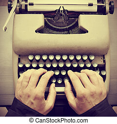 man typing on an old typewriter, with a retro effect