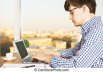 Man typing on keyboard side