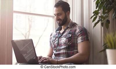 Man Typing on Laptop - Successful businessman working from...