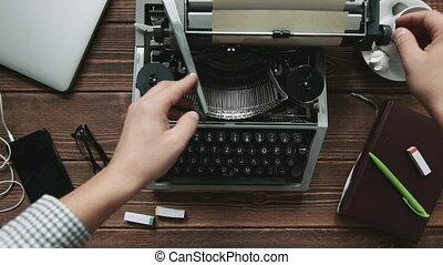 Man typing on typewriter - Cropped shot of typist working on...