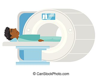 Man undergoes a magnetic resonance imaging scan. - Young...