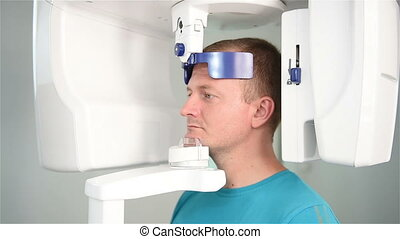 man undergoing tests on X-Ray