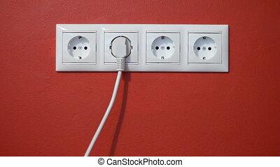 Man unplug and push electric plug