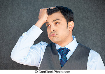 Man upset with hand on head