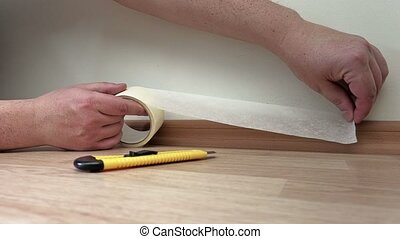 Man use adhesive tape close up