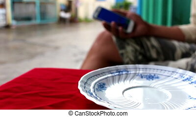 Man use mobile phone in a cafe