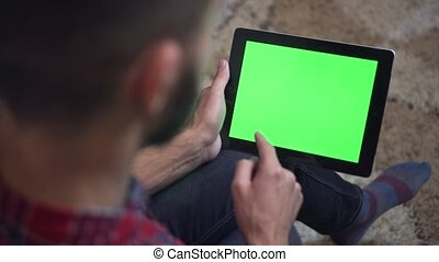 Man Use Tablet PC with Green Screen