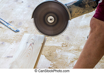 Man using a circular saw to cut floor material