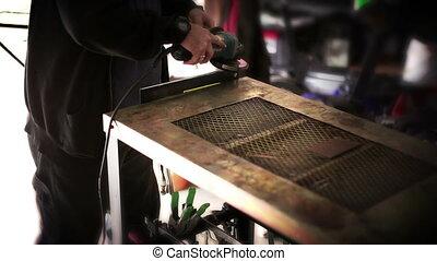 Man using a grinder enhanced colors