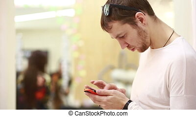 man using a mobile phone,