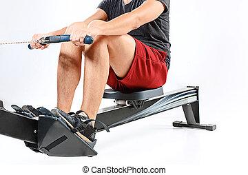 Man Using A Press Machine In A Fitness Club.