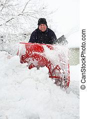 Man using a snowblower