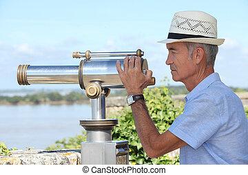 Man using a telescope
