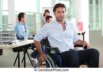 Man using a wheelchair in an office environment