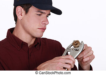 Man using a wrench