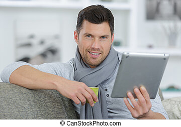 man using an apple tablet