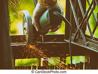 Man using angle grinder