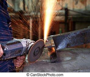Man using angle grinder.