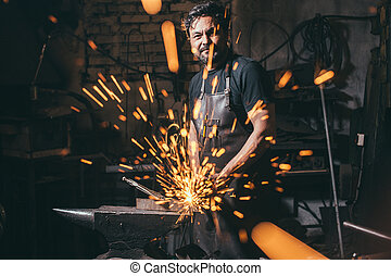 man using angle grinder sparks
